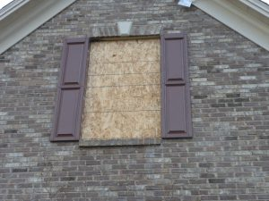 boarded up window in knoxville, tn 2