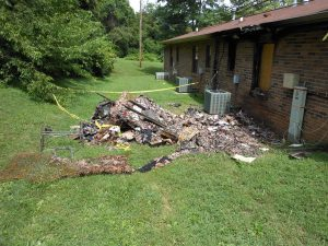fire damage debris outside home