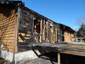 home exterior with fire damage
