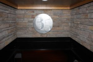 latitude 35 logo on renovated stone wall